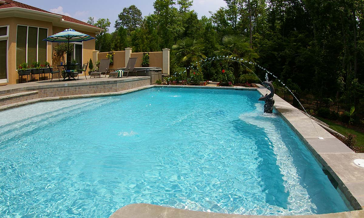 Charlotte pool house builder and pool builder with outdoor patio area