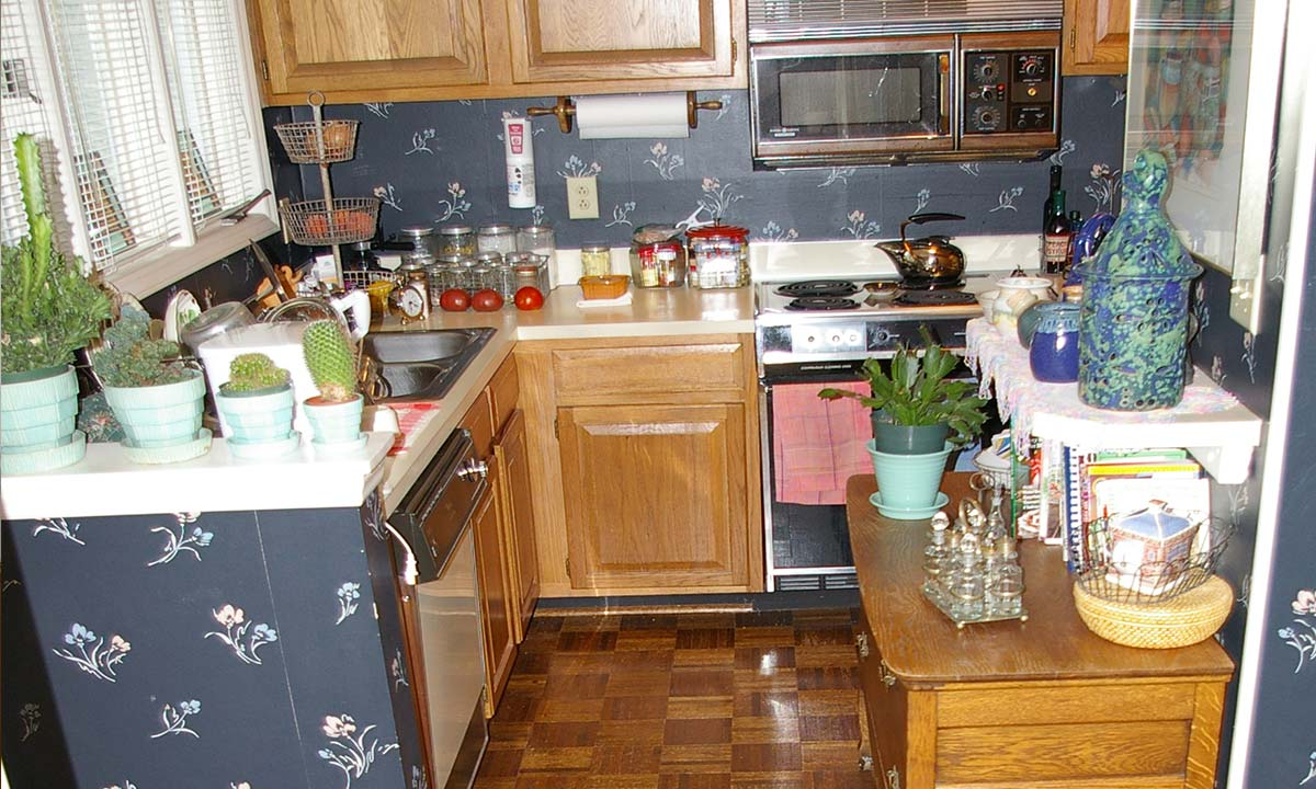 View of the original small kitchen with almost no space for moving