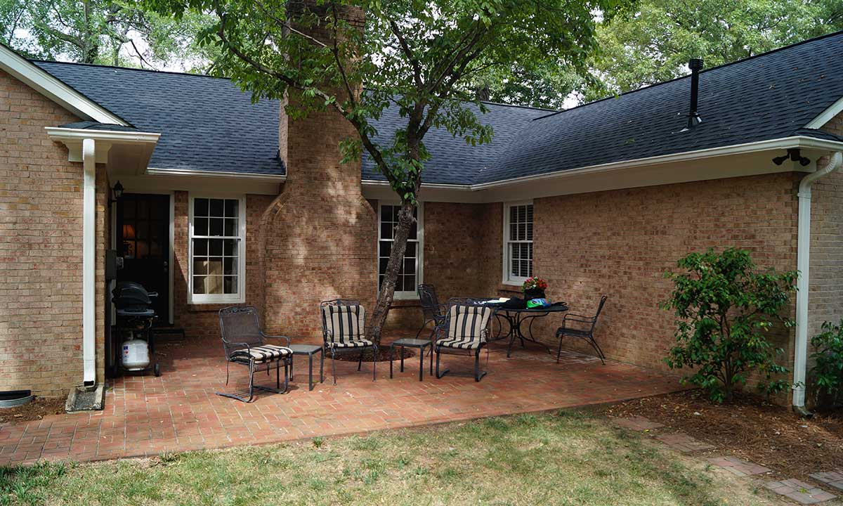 Before screened porch addition with U-shaped courtyard and cumbersome tree