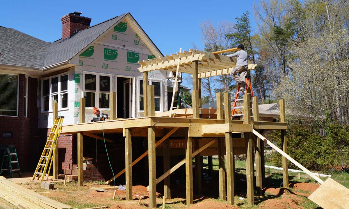Construction of sunroom, deck and and sunken hot tub