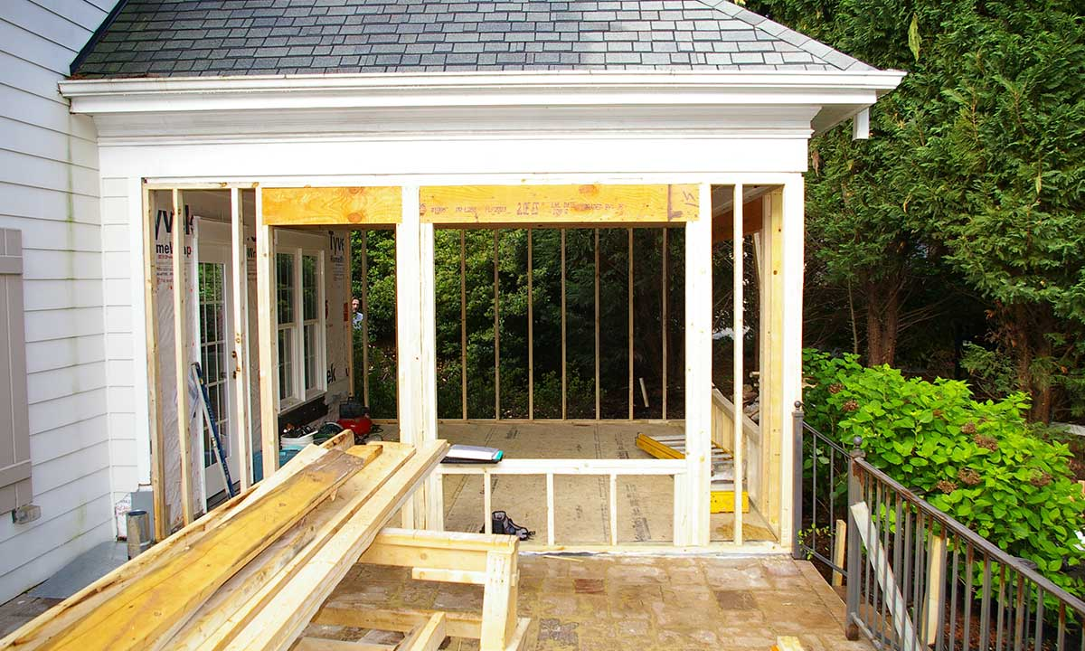 Construction photo showing sunroom being completely re-engineered and reframed for the space