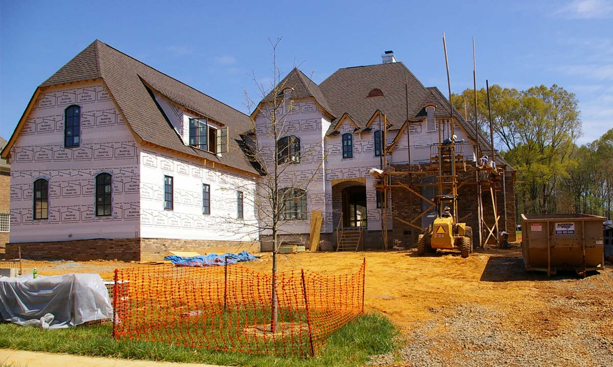 Tuscan country manor, a custom home built near Charlotte, NC, is under construction in this photo