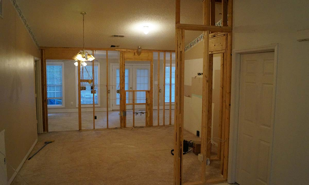 Removing existing walls to open the kitchen to the new family room