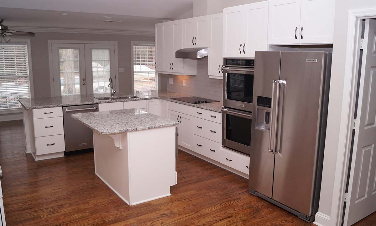"""Transformative """"after"""" photo of the interior space of this kitchen remodel"""