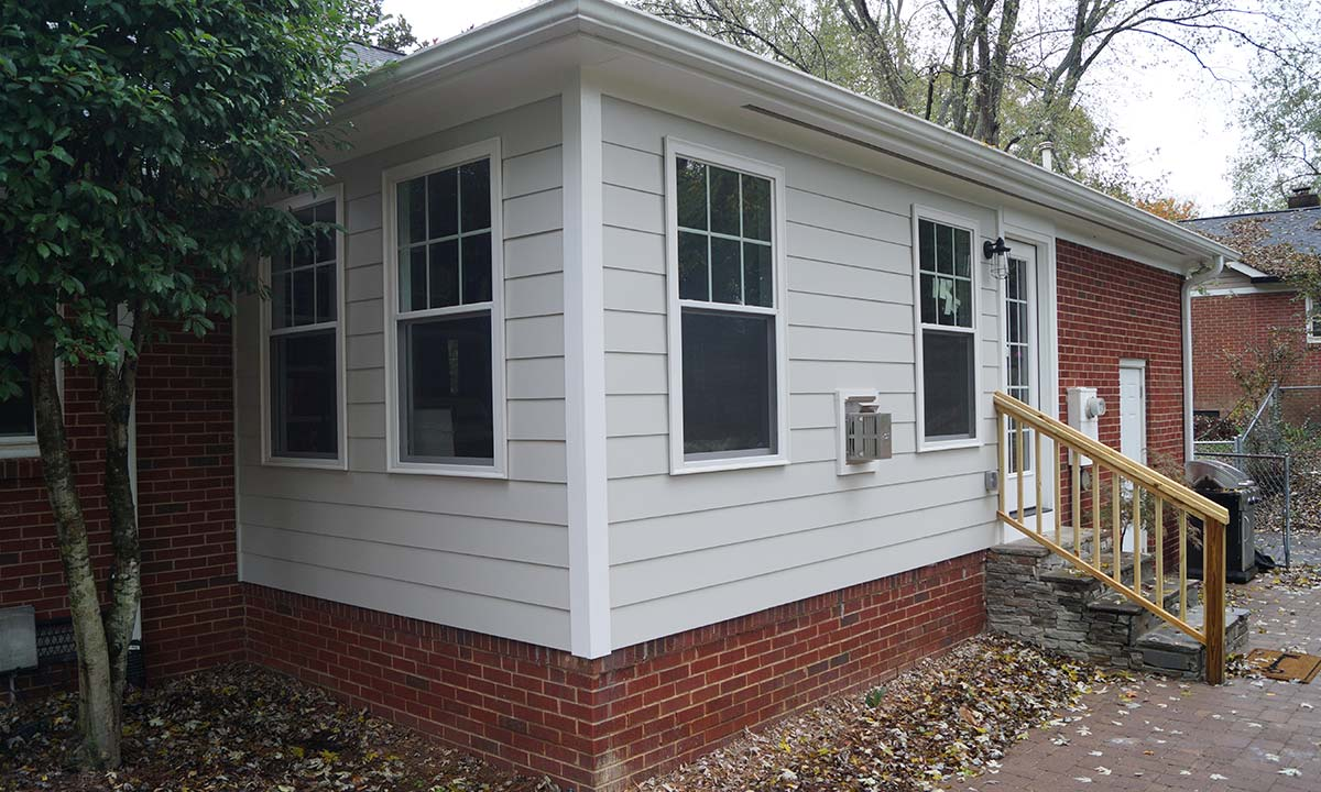 Exterior view of home's new sunroom converted from a screened porch
