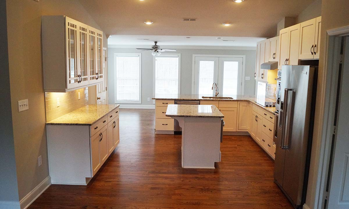 Picture of whole kitchen and new floor plan of this remodeled home