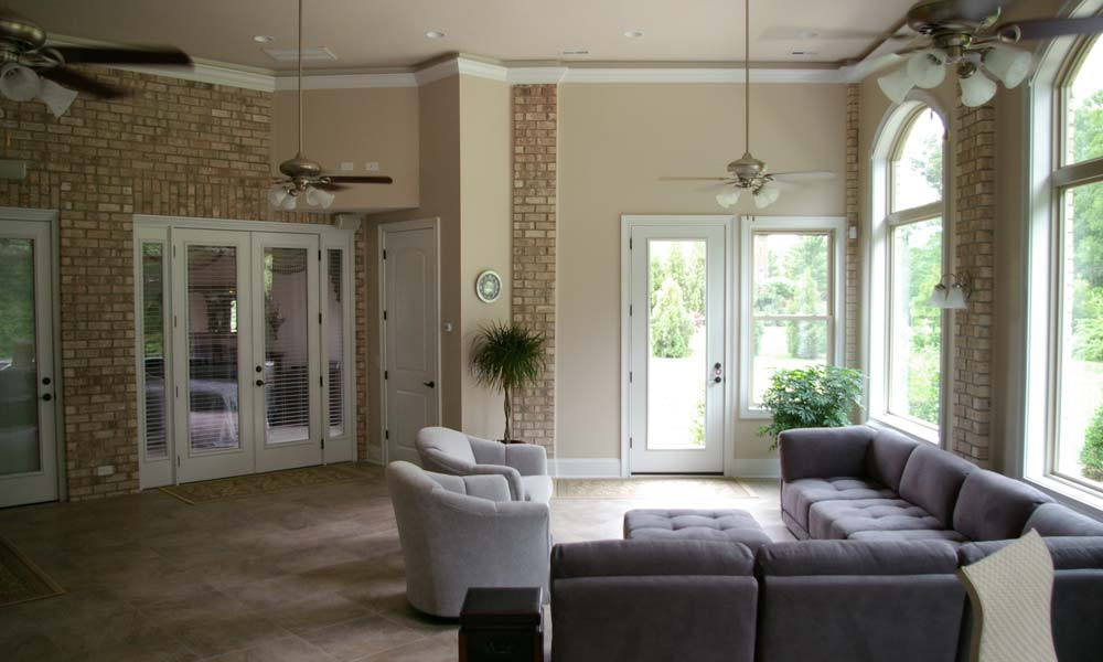 Interior photo of a sunroom addition and all season room done for a home in Charlotte