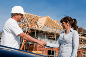 Contractor Shaking Hands with Happy home Owner