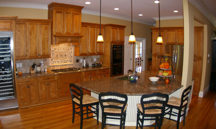 Interior photo an affordable kitchen renovation that shows updated cabinets, appliances and countertops