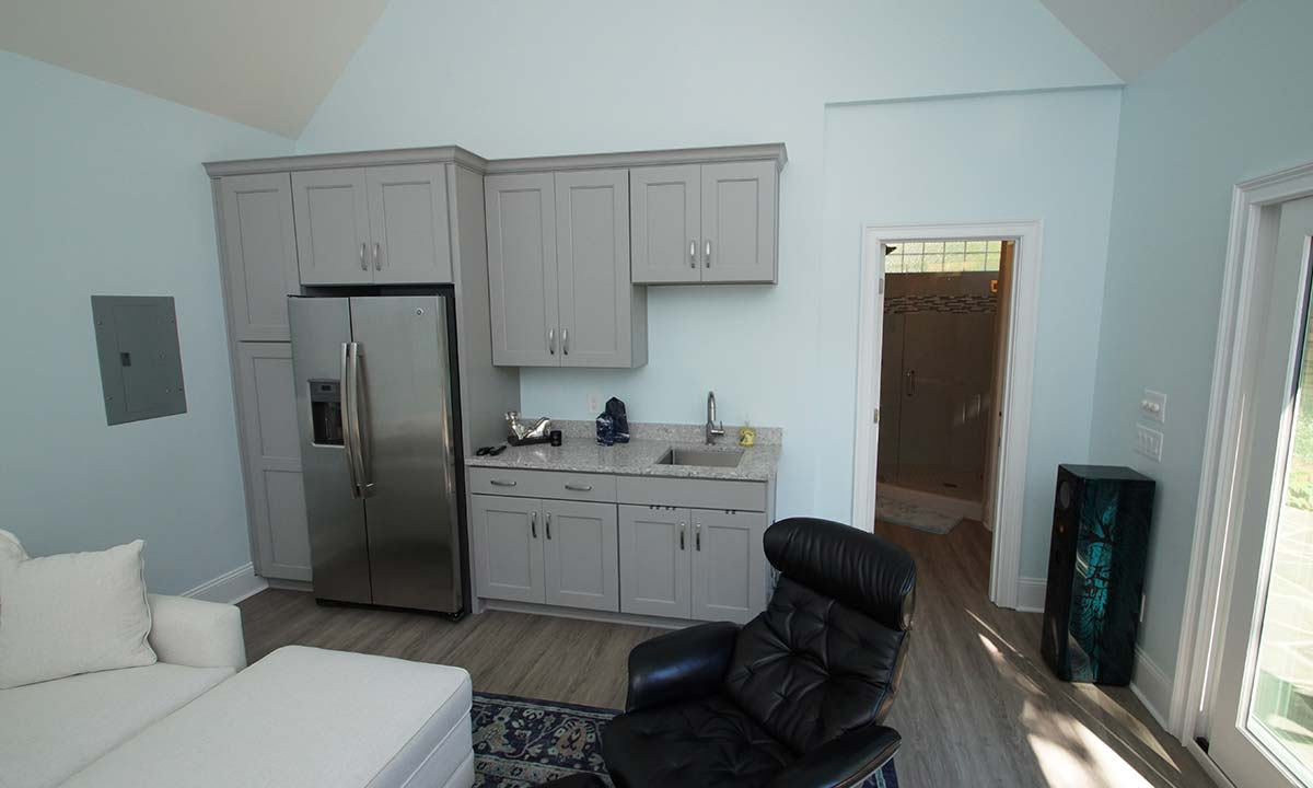 Pool house interior living space and kitchenette