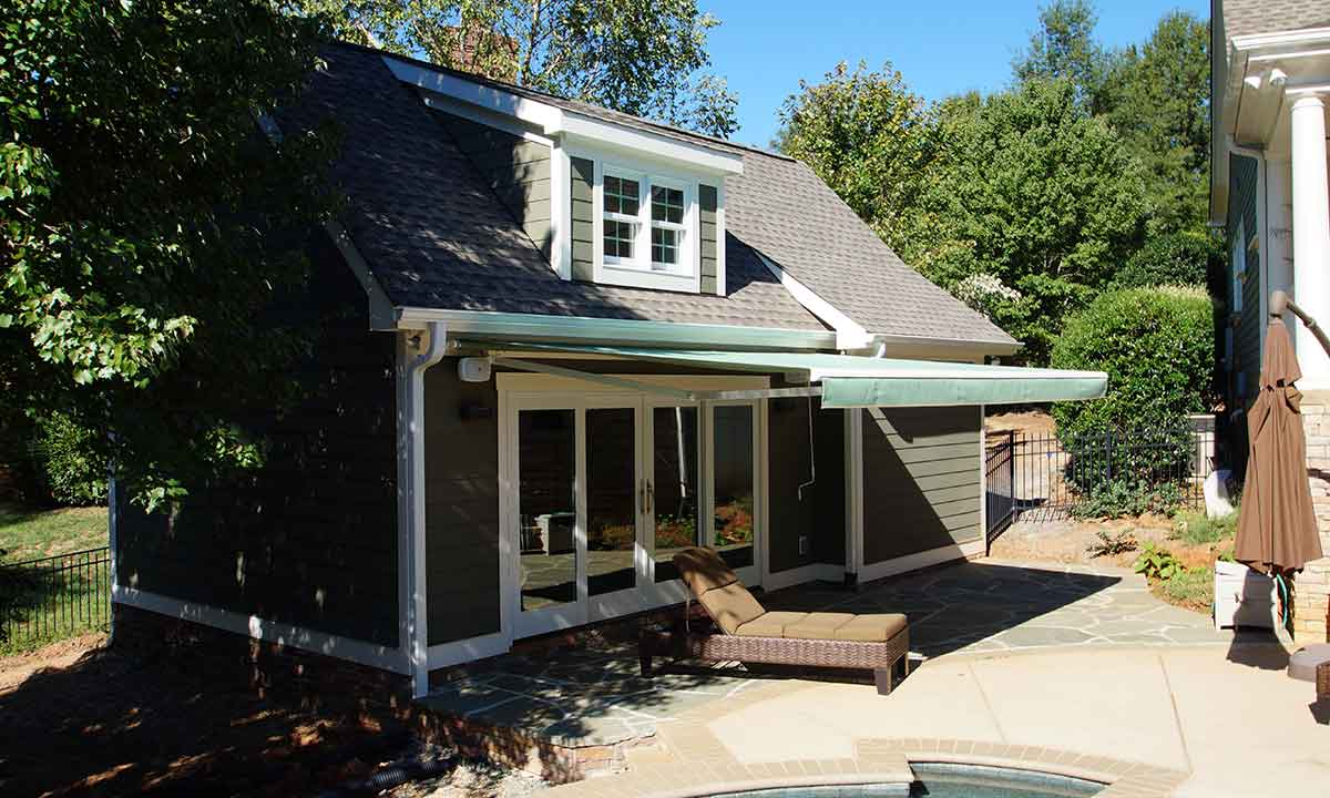 Completed Pool House Sunroom and New Retractable Awning Exterior