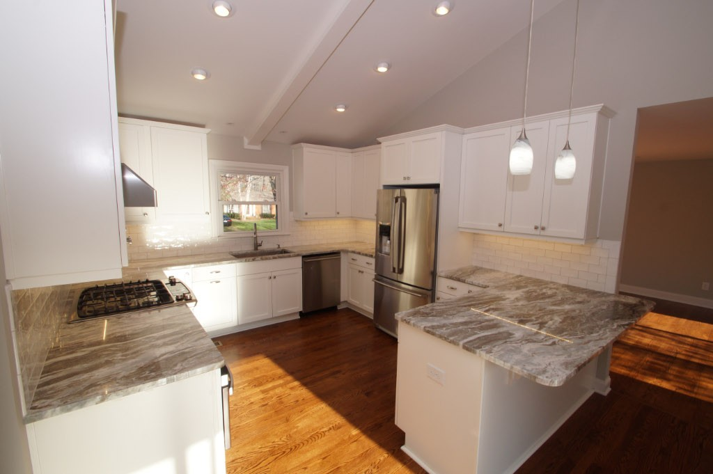 kitchen remodel with gray granite and white cabinets