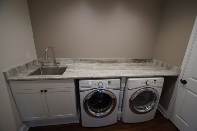 laundry room addition with granite countertops