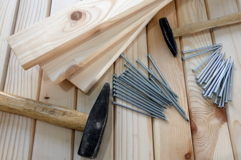 carpentry image with wood, nails, and hammer