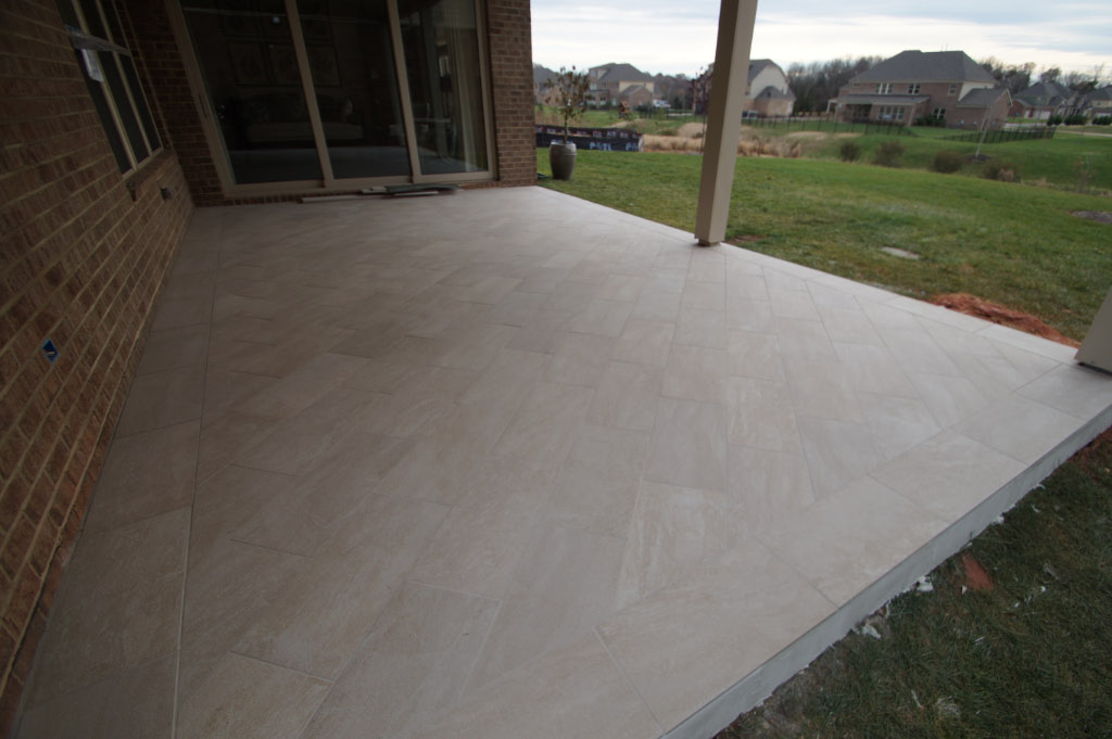 laying the tile for screened in porch addition