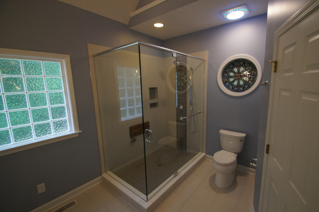 after photo of bathroom remodel with glass shower