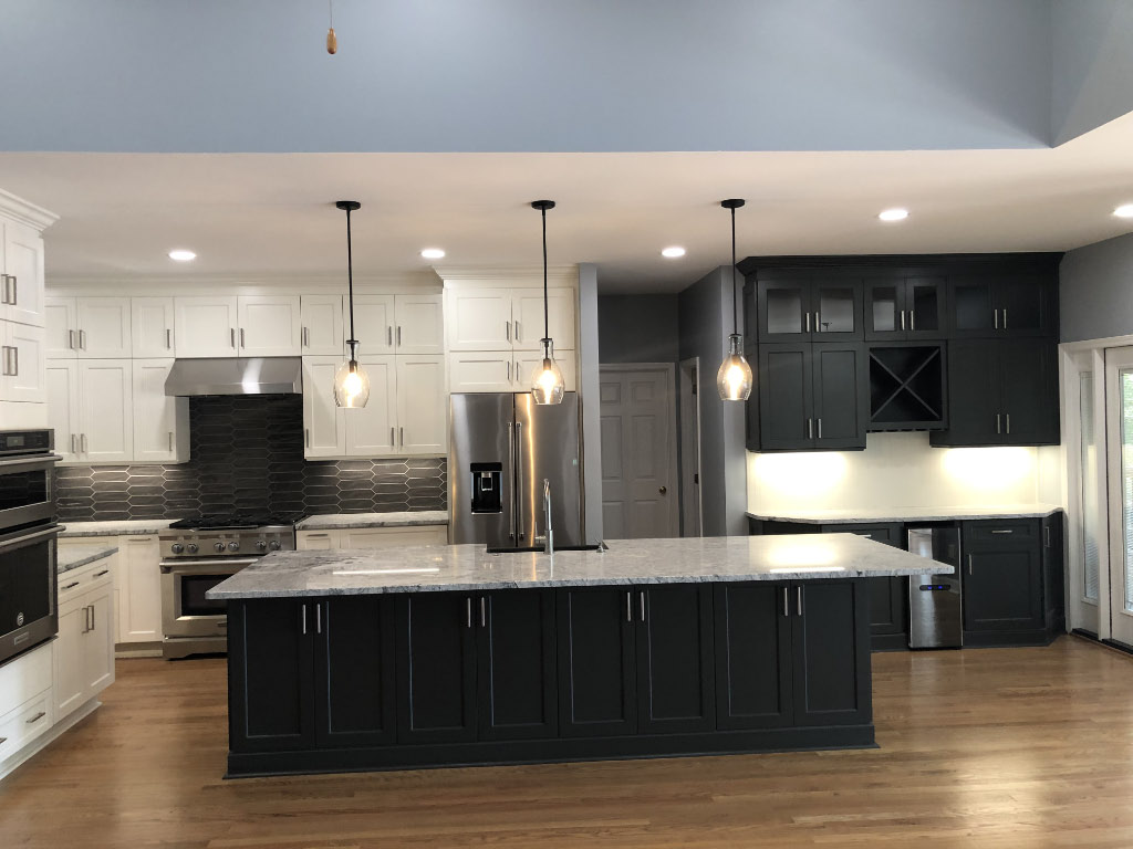 after pitcure of kitchen remodel with black island