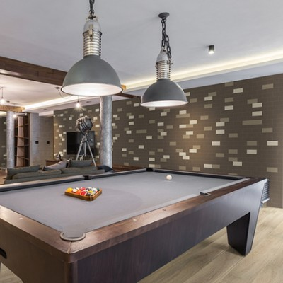 pool table room with statement tile wall