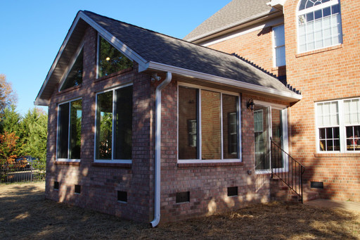 exterior photo of brick enclosed sunroom addition