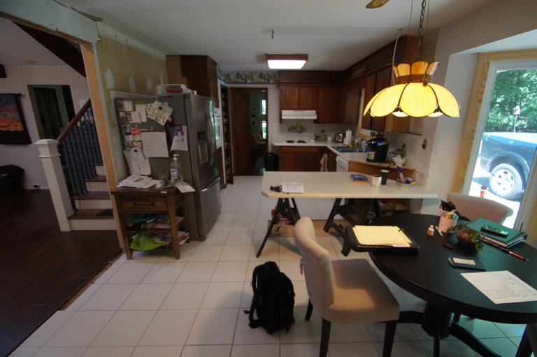 before image of kitchen with dark cabinets and laminent countertops