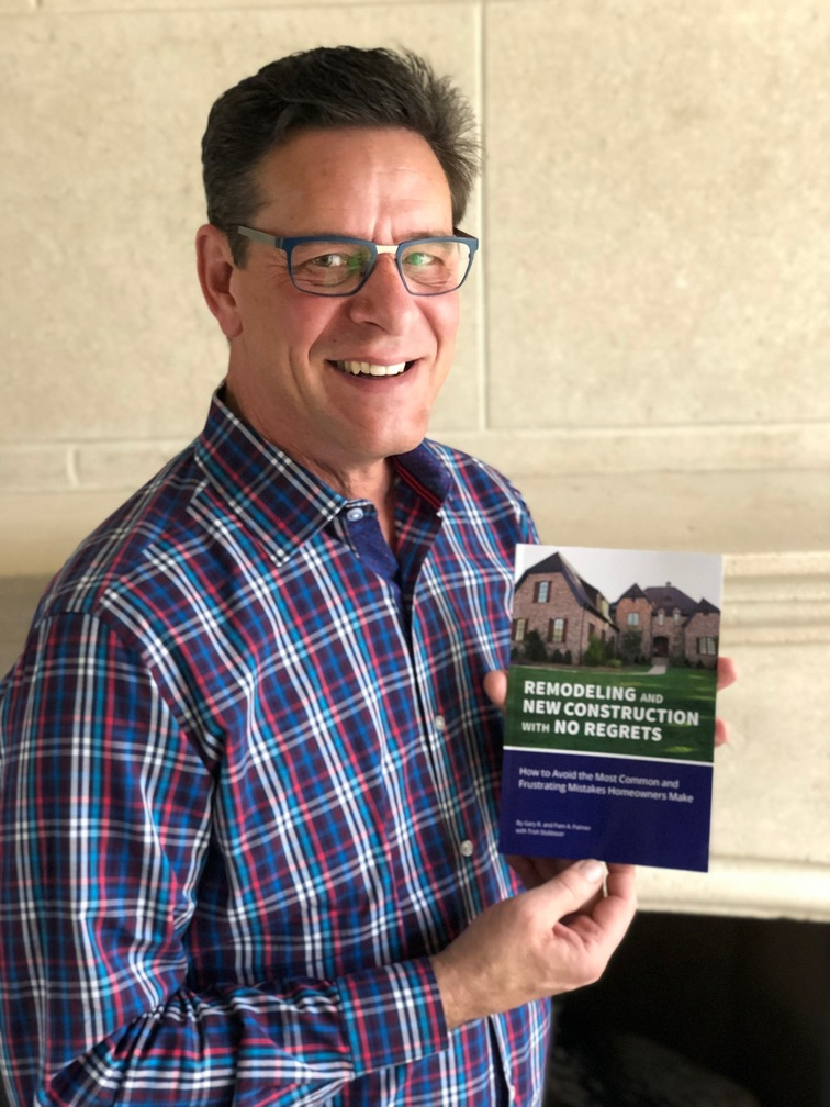 picture of co-author Gary Palmer holding book