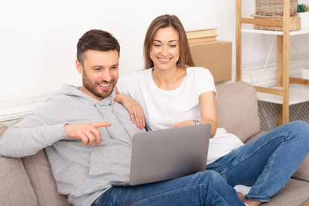 homeowners looking at laptop